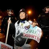 Christy Wong protests at the Port of Oakland on Monday, Dec. 12, 2011, in Oakland, Calif.