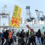 Protesters form a picket line outside Port of Oakland Berths 30-32 on Monday, Dec. 12, 2011, in Oakland, Calif.