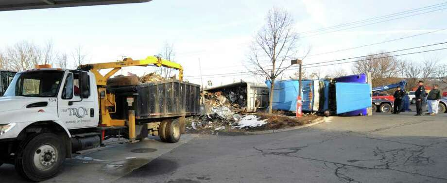 A truck carrying scrap metal overturned at the intersection of Oakwood Avenue and Northern Drive in Troy on Monday, Dec. 12, 2011, impeding traffic.    (Skip Dickstein / Times Union) Photo: SKIP DICKSTEIN