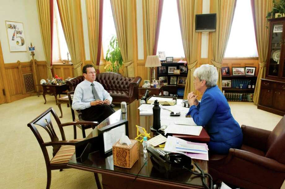 Gov. Dan  Malloy meets with Lt Gov. Nancy Wyman in her office at the State Capitol in Hartford, Conn., October 25, 2011, one day before a special session to approve a bipartisan jobs bill and a controversial aid package for The Jackson Laboratory. Photo: Keelin Daly / Stamford Advocate