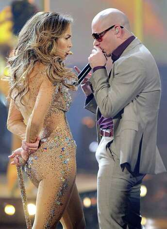 LOS ANGELES, CA - NOVEMBER 20:  Singer Jennifer Lopez and rapper Pitbull perform onstage at the 2011 American Music Awards held at Nokia Theatre L.A. LIVE on November 20, 2011 in Los Angeles, California. Photo: Kevork Djansezian, Getty Images / 2011 Getty Images