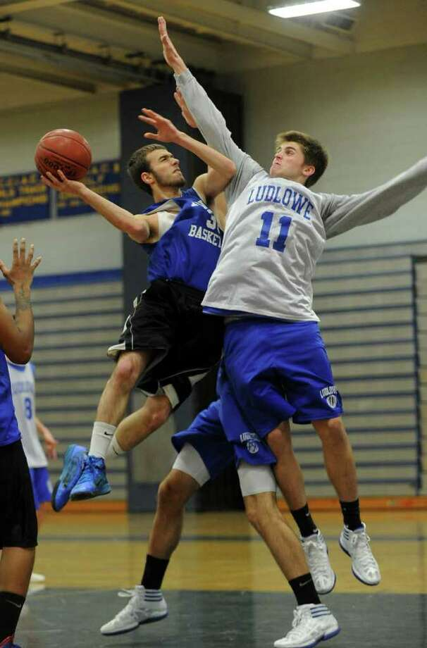 Highlights from boys basketball scrimage action betwen Fairfield Ludlowe and Bunnell in Stratford, Conn. on Thursday Dec. 8, 2011. Ludlowe's #11 Tyler Bulkley, right, looks to block a shot attempt by Bunnell's #35 Carmine Santorelli. Photo: Christian Abraham / Connecticut Post