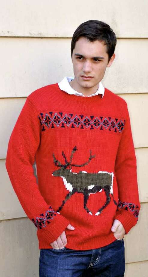 Chathan Raj picked up a tacky holiday sweater at Urban Outfitters. Photo: DYLAN AGUILAR