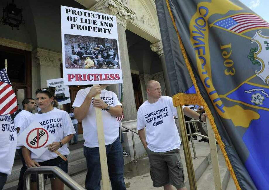 The Connecticut State Police Union holds a rally at the Capitol in Hartford, Conn., Monday, Aug. 22, 2011.  Union leaders say state police are already understaffed and cutting 56 troopers is a dangerous proposal that could result in slower emergency response times. After state police refused to accept a wage freeze, the governor laid off more than 50 troopers. Photo: Jessica Hill, Associated Press / AP2011