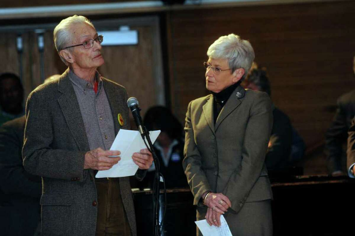 Malcolm Dexter, of Greenwich, spoke in support of the Sustinet health care reform plan at Gov. Dan Malloy's town hall-style meeting at Eastern Middle School in Riverside, on Monday, March 28, 2011. Lt. Gov. Nancy Wyman listens at right.