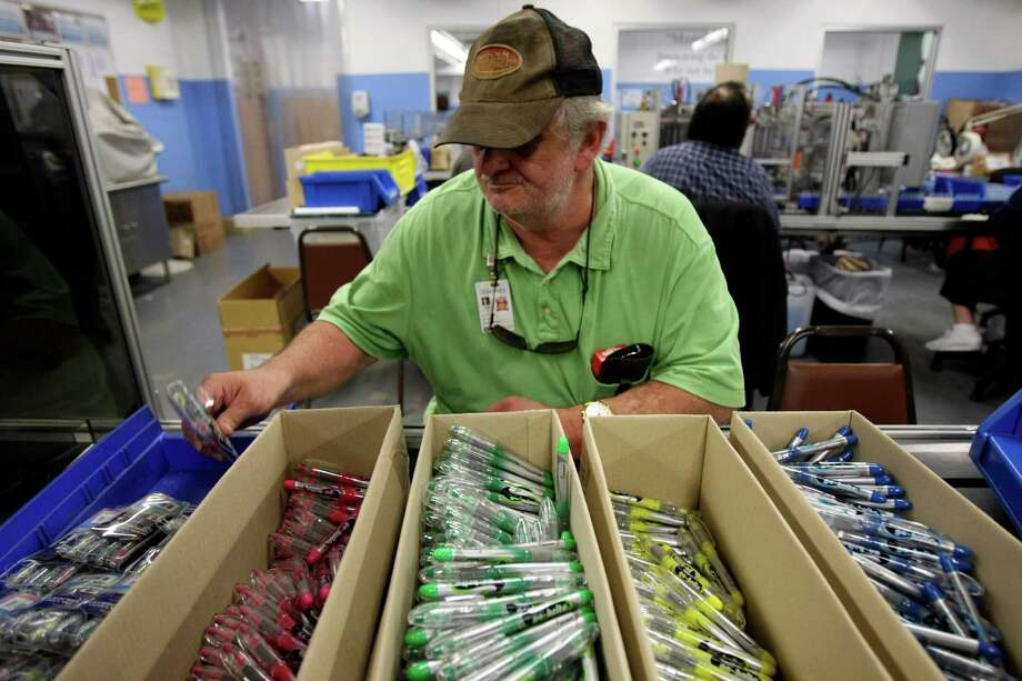 Arnold Tackett assembles packets of highlighters at the Lighthouse on Tuesday Nov. 29, 2011. The Lighthouse employs blind and legally blind employees. HELEN L. MONTOYA/hmontoya@express-news.net Photo: HELEN L. MONTOYA, San Antonio Express-News / SAN ANTONIO EXPRESS-NEWS