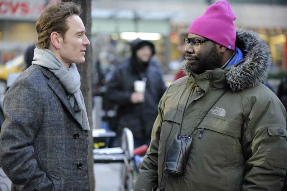 FOX SEARCHLIGHT NY STREETS: Writer/director Steve McQueen, right, and  Michael Fassbender discuss a scene on the set of Shame. Photo: Fox Searchlight