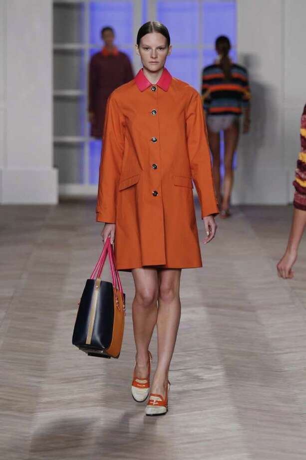 This September 2011 photo courtesy of Tommy Hilfiger, U.S.A., shows a model wearing a design from the Tommy Hilfiger Spring 2012 women?s collection during Fashion Week in New York. Pantone has chosen a reddish-orange hue as their top color of the year for 2012.   (AP Photo/Tommy Hilfiger, U.S.A. ) / Tommy Hilfiger, U.S.A.