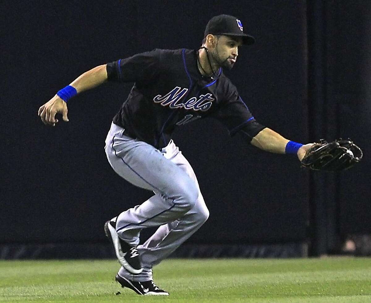 New York Mets center fielder Angel Pagan makes a running catch to take a hit away from San Diego Padres' Kyle Blanks during the third inning of a baseball game, in this Aug. 16, 2011 file photo taken in San Diego. In a rapid-fire series of moves at the winter meetings that took 1½ days to put together and 1½ hours to finalize, the Mets agreed to trade center fielder Angel Pagan to San Francisco for outfielder Andres Torres and pitcher Ramon Ramirez. (AP Photo/Lenny Ignelzi, File) Ran on: 12-08-2011 Outfielder Angel Pagan, who played for the Mets last year, will be one of the Giants new faces. Ran on: 12-08-2011 Outfielder Angel Pagan, who played for the Mets last year, will be one of the Giants new faces. Ran on: 12-08-2011 Outfielder Angel Pagan, who played for the Mets last year, will be one of the Giants new faces.