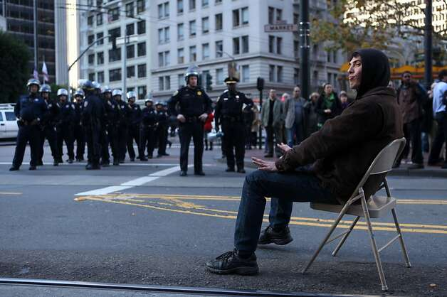 Colin Rider of SF Occupy remains in the middle of Market Street after being order to vacate or be arrested, Wednesday Dec. 7, 2011 in San Francisco, Calif. Rider was one of three who were arrested. Ran on: 12-08-2011 Colin Rider of Occupy SF takes a seat in Market Street and gets arrested. Ran on: 12-08-2011 Colin Rider of Occupy SF takes a seat in Market Street and gets arrested. Ran on: 12-08-2011 Colin Rider of Occupy SF takes a seat in Market Street and gets arrested. Ran on: 12-08-2011 Colin Rider of Occupy SF takes a seat in Market Street and gets arrested. Ran on: 12-08-2011 Colin Rider of Occupy SF takes a seat in Market Street and gets arrested. Ran on: 12-08-2011 Colin Rider of Occupy SF takes a seat in Market Street and gets arrested. Ran on: 12-08-2011 Colin Rider of Occupy SF takes a seat in Market Street and gets arrested. Photo: Lacy Atkins, The Chronicle