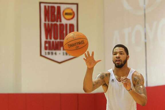 Houston Rocket's Marcus Morris shoots free throws during the Rockets training Camp at the Toyota Center on Monday, Dec. 12, 2011, in Houston.