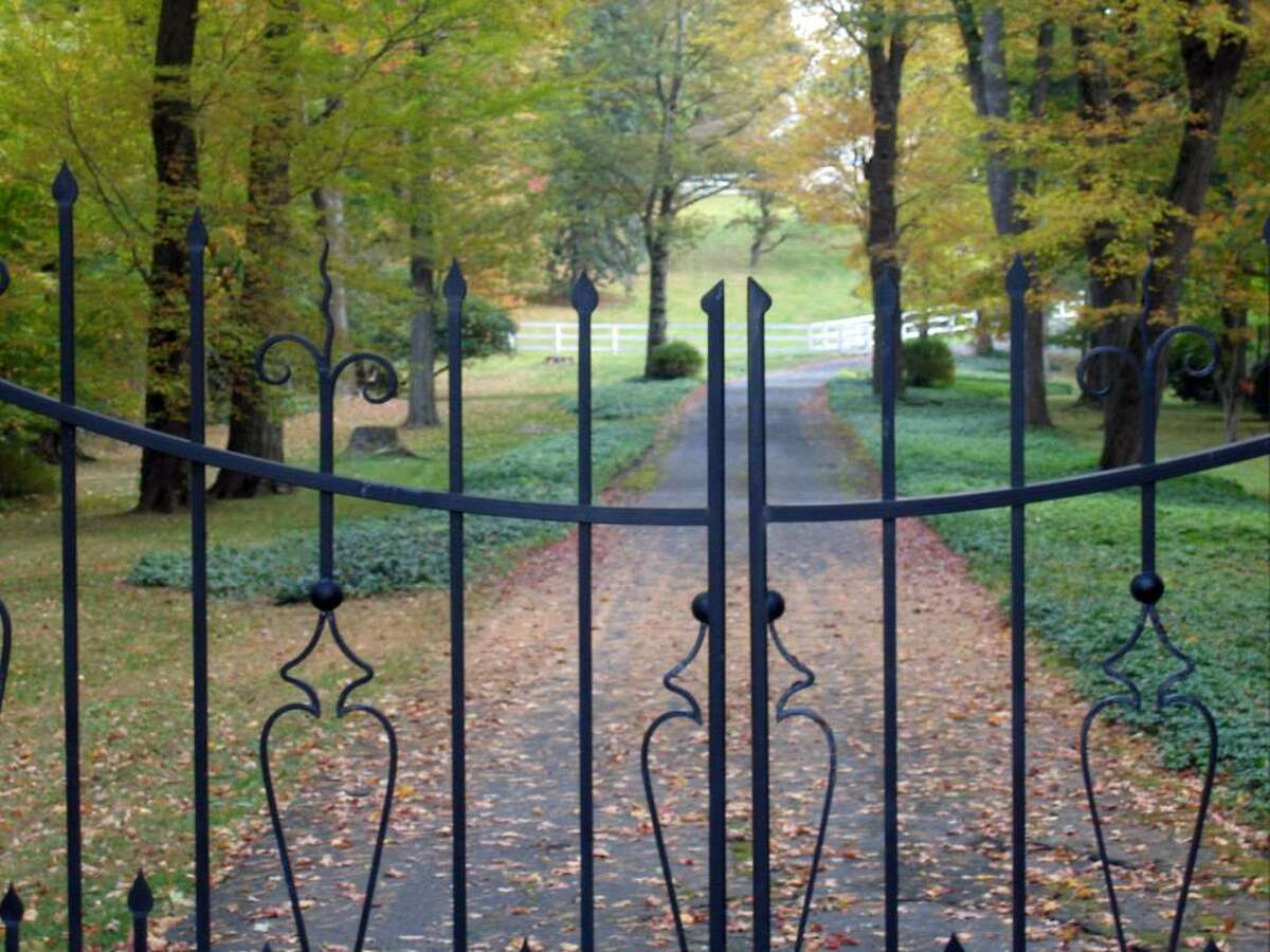 Billionaire Raj Rajaratnam's gated estate on Round Hill Road, Wednesday, Oct. 21, 2009. Rajaratnam is a hedge fund boss and accused mastermind of a $25 million insider trading scam.