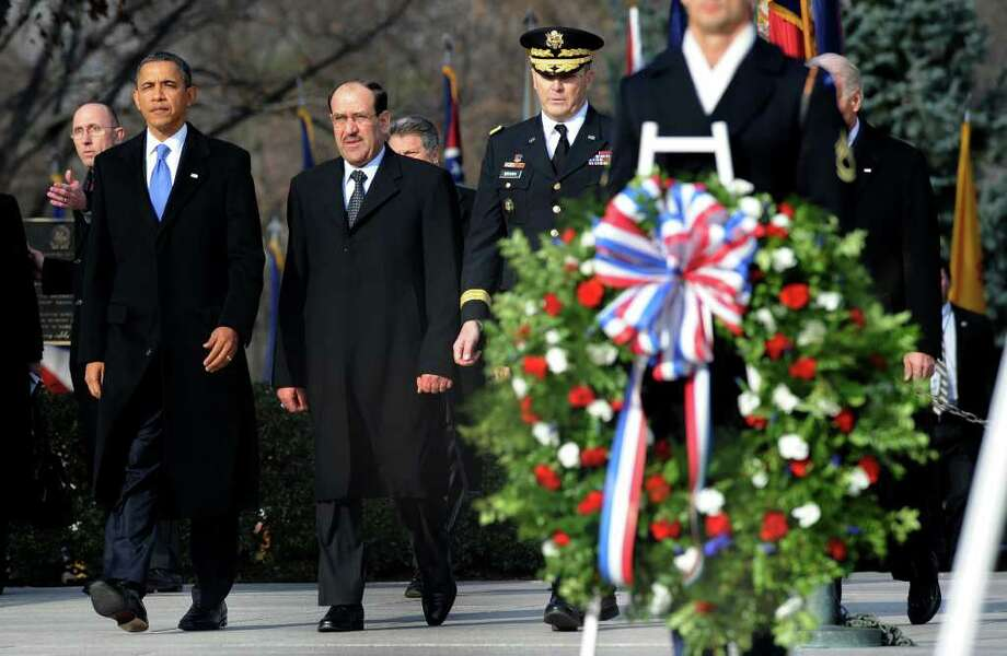 OLIVIER DOULIERY : GETTY IMAGES  HONORING THE FALLEN: President Barack Obama and Iraqi Prime Minister Nouri al-Maliki participate in a wreath laying ceremony Monday at Arlington National Cemetery in Virginia, saluting America's war dead. Photo: Pool / 2011 Getty Images