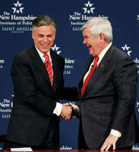 Republican presidential candidates, former Utah Gov. Jon Huntsman, left, and former House Speaker Newt Gingrich shake hands after a one-on-one debate in Manchester, N.H., Monday, Dec. 12, 2011. (AP Photo/Elise Amendola) Photo: Elise Amendola / AP
