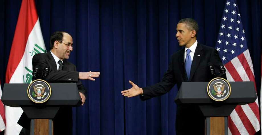 President Barack Obama and Iraq's Prime Minister Nouri al-Maliki shake hands in the South Court Auditorium at the White House in Washington, Monday, Dec. 12, 2011. (AP Photo/Carolyn Kaster) Photo: Carolyn Kaster
