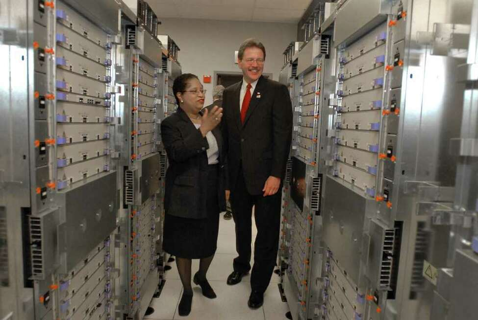 RPI President Shirley Ann Jackson walks with IBM's John Kelly lll through the supercomputing center at the Rensselaer Technology Park in North Greenbush. Grant money sought to help fund a $125 million supercomputer was not awarded. Times Union staff photo by Lori Van Buren Lori Van Buren/TIMES UNION