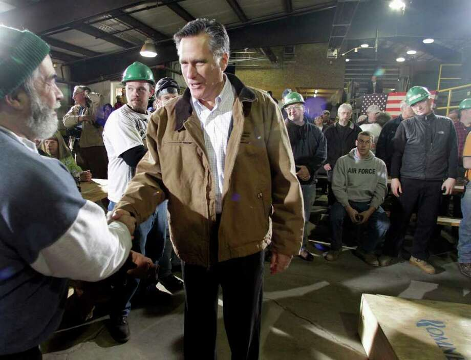 Republican presidential candidate, former Massachusetts Gov. Mitt Romney greets mill workers at the Madison Lumber Mill, Monday, Dec. 12, 2011 in Madison, N.H. (AP Photo/Jim Cole) Photo: Jim Cole