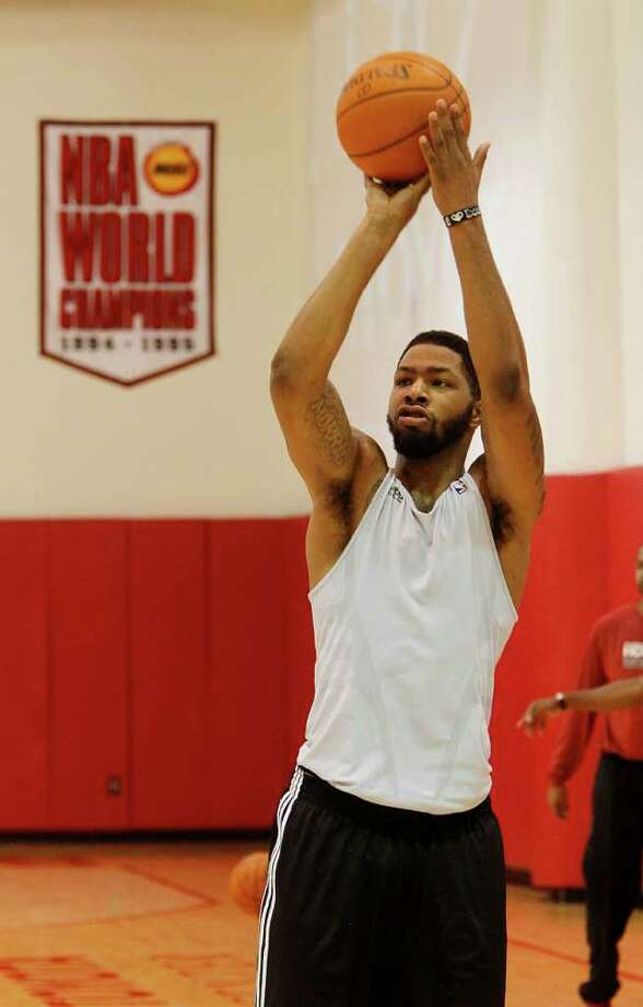 MAYRA BELTRAN: CHRONICLE BANNER YEAR?: Coach Kevin McHale said rookie Marcus Morris, shooting free throws during training camp Monday, has the strength and ability to help the Rockets this season. Photo: Mayra Beltran / © 2011 Houston Chronicle