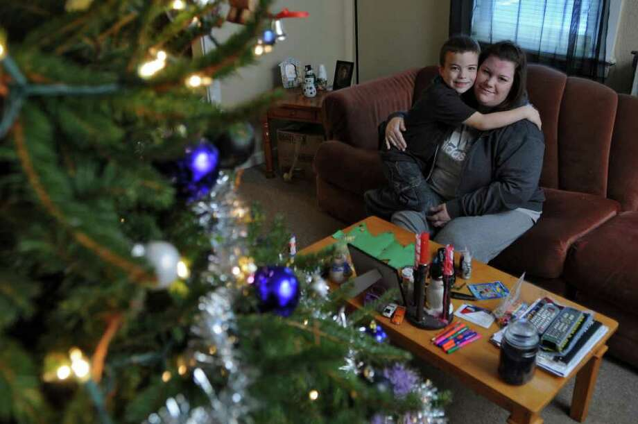 6 year old son Aaron Wright and his mother Nikki Dober were in a car accident on Saturday, and Aaron climbed out and helped direct emergency crews to the scene afterwards. They relax in the living room of their home on Monday Dec. 12, 2011 in East Berne, N.Y.    (Philip Kamrass / Times Union ) Photo: Philip Kamrass / 00015754A