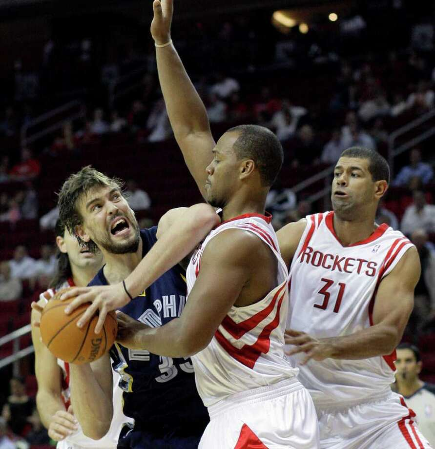 Grizzlies center Marc Gasol, left, averaged 11.7 points and 7 rebounds a game during the 2010-11 season. Photo: Pat Sullivan, AP / AP