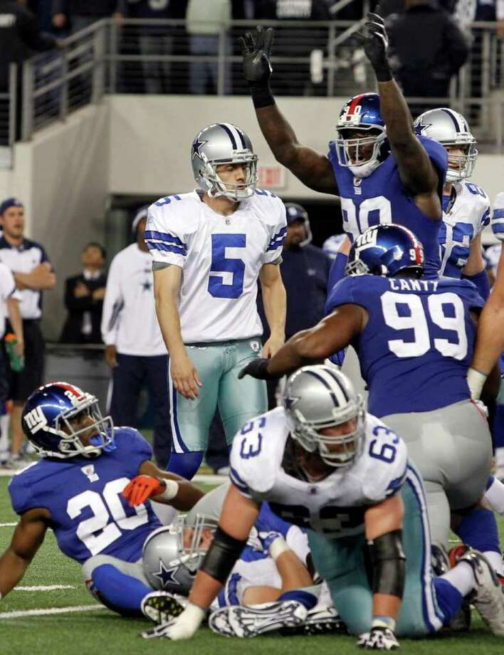 The New York Giants celebrate after Dallas Cowboys' Dan Bailey, center,  had his field goal attempt blocked  during the final seconds of an NFL football game against the New York Giants Sunday, Dec. 11, 2011, in Arlington, Texas.  New York won 37-34. (AP Photo/Sharon Ellman) Photo: Sharon Ellman