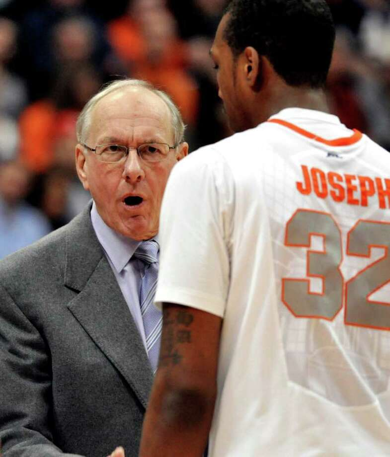 Syracuse head coach Jim Boeheim, left, talks to Kris Joseph during a time-out in the second half against George Washington in an NCAA college basketball game in Syracuse, N.Y., Saturday, Dec. 10, 2011. Syracuse won 85-50. (AP Photo/Kevin Rivoli) Photo: Kevin Rivoli