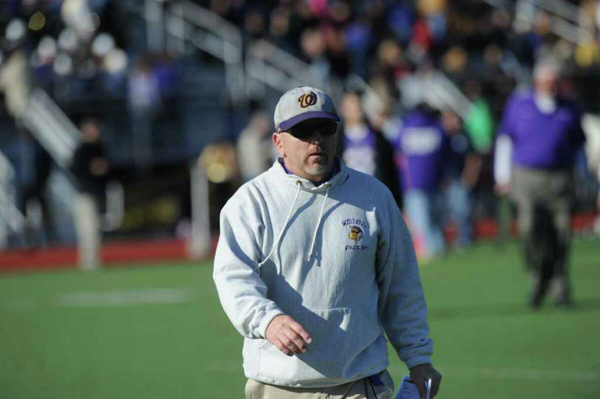 Westhill High football Coach Dick Cerone on the field as Westhill High School hosts Stamford High for a crosstown battle on the football field on Thanksgiving Day, November 24, 2011.