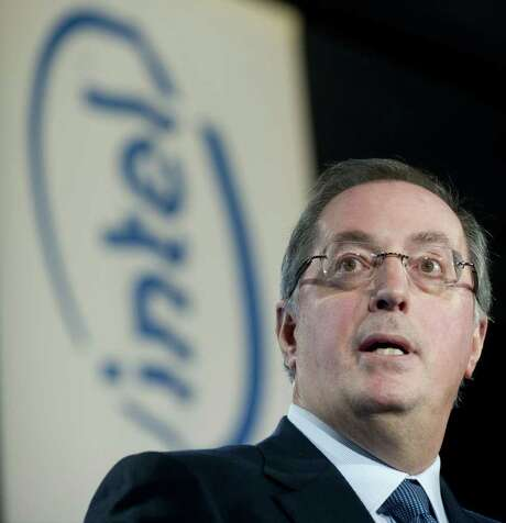 Intel CEO Paul Otellini introduces US President Barack Obama before he speaks about advancing education for US students to compete on the international stage after touring a manufacturing facility at Intel in Hillsboro, Oregon, February 18, 2011. AFP PHOTO / Saul LOEB (Photo credit should read SAUL LOEB/AFP/Getty Images) Photo: SAUL LOEB / AFP