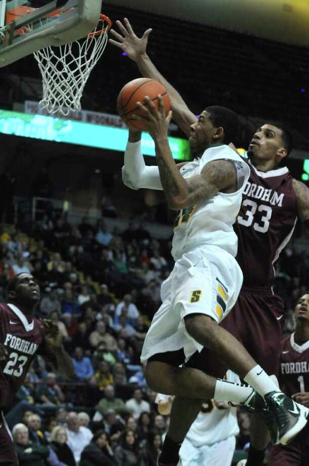 Siena's Davonte Beard is defended by Fordham's Chris Gaston, right,  during the second half of Siena's 74-59 loss at the Times Union Center on Monday night Dec. 12, 2011 in Albany, N.Y.    (Philip Kamrass / Times Union ) Photo: Philip Kamrass / 00015373D
