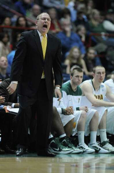 Siena head coach Mitch Buonaguro  disagrees with a call during the second half of Siena's 74-59 loss