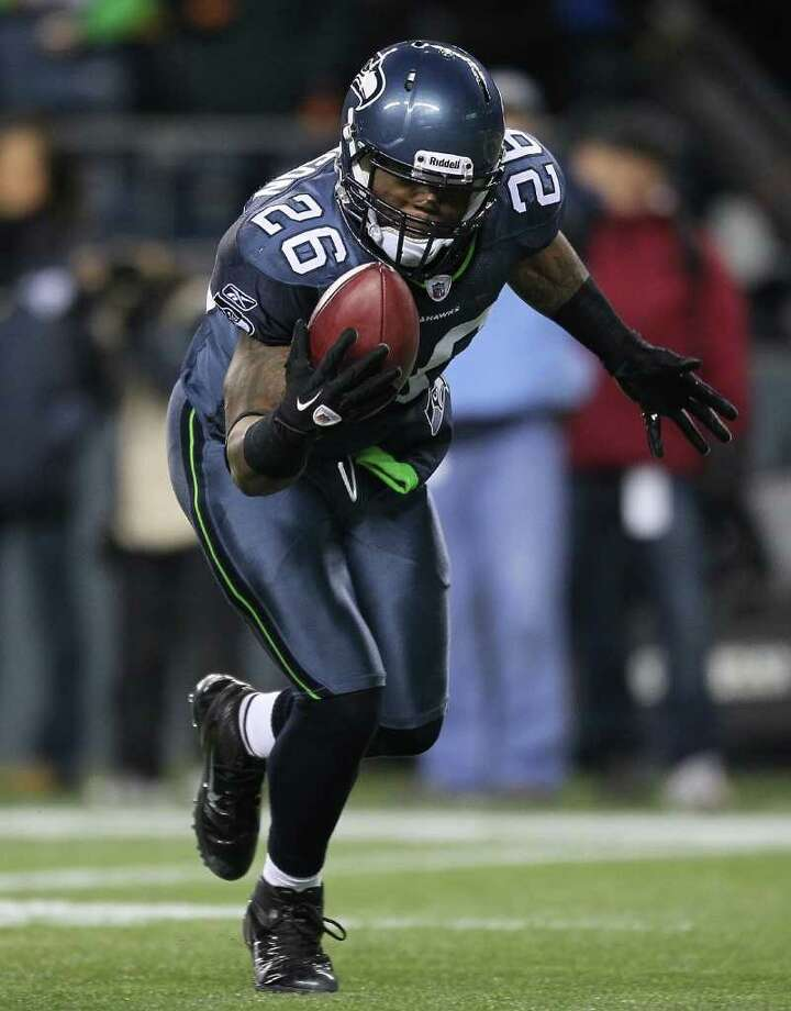 SEATTLE - DECEMBER 12:  Michael Robinson #26 of the Seattle Seahawks recovers a punt blocked by Doug Baldwin and returns it for a touchdown against the St. Louis Rams at CenturyLink Field on December 12, 2011 in Seattle, Washington. (Photo by Otto Greule Jr/Getty Images) Photo: Otto Greule Jr