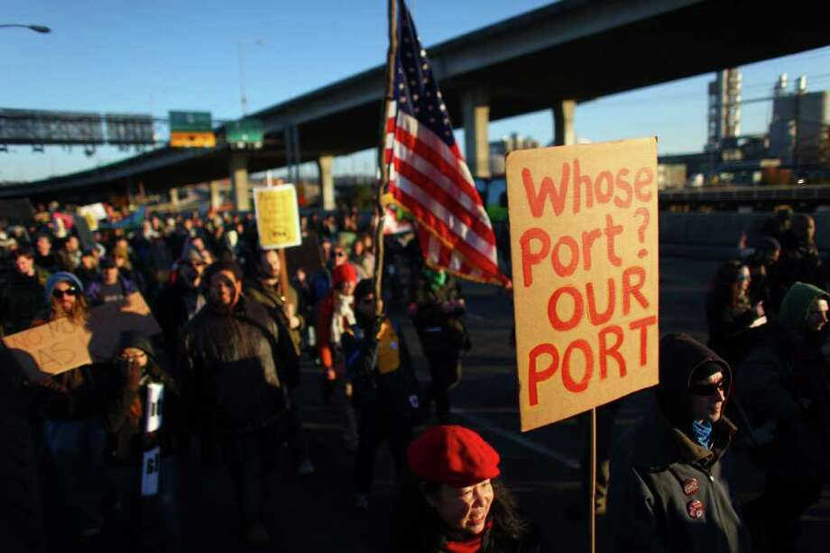 Protesters march toward the Port of Seattle on Monday, December 12, 2011 at the Port of Seattle. Hundreds of anti-Wall Street protesters gathered at the port and tried to shut down operations. Protesters scuffled with police during the rally and police used pepper spray and two flash-bang grenades to disperse the crowd after a protester threw a lit road flare toward officers. Another threw red paint on officers. Photo: JOSHUA TRUJILLO / SEATTLEPI.COM