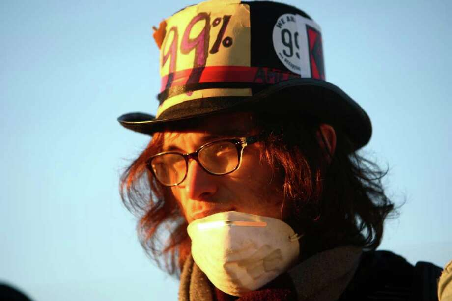 A protester wears a hat on Monday, December 12, 2011 at the Port of Seattle. Hundreds of anti-Wall Street protesters gathered at the port and tried to shut down operations. Protesters scuffled with police during the rally and police used pepper spray and two flash-bang grenades to disperse the crowd after a protester threw a lit road flare toward officers. Another threw red paint on officers. Photo: JOSHUA TRUJILLO / SEATTLEPI.COM