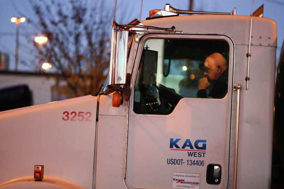 A truck driver waits for the road to open on Monday, December 12, 2011 at the Port of Seattle. Hundreds of anti-Wall Street protesters gathered at the port and tried to shut down operations. Protesters scuffled with police during the rally and police used pepper spray and two flash-bang grenades to disperse the crowd after a protester threw a lit road flare toward officers. Another threw red paint on officers. Photo: JOSHUA TRUJILLO / SEATTLEPI.COM