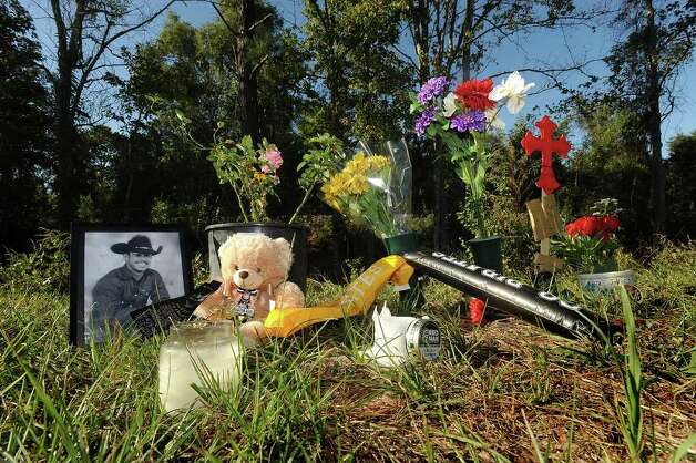A memorial for Matt Thomas was set up near the train tracks were he was killed early Sunday morning. Thomas played defense for the Vidor Pirates. Photo taken Monday, October 17, 2011. Guiseppe Barranco/The Enterprise