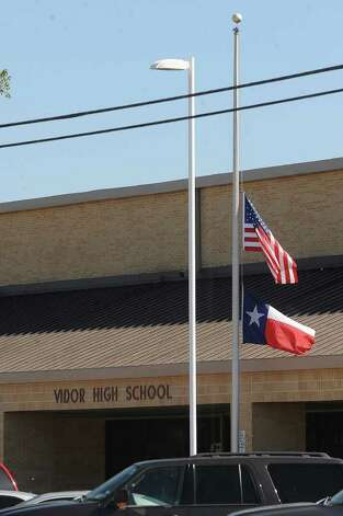 The Texas and American flag fly at half staff Monday in respect for Matt Thomas who was killed by a train early Sunday morning. Photo taken Monday, October 17, 2011. Guiseppe Barranco/The Enterprise
