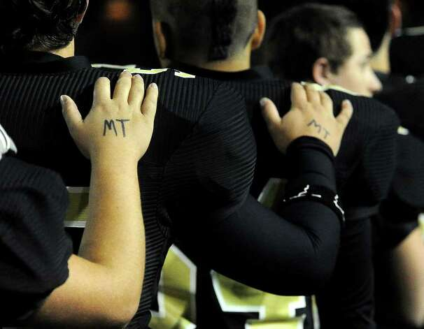 Vidor Pirates wear the initials of Matt Thomas during the game against Crosby at Provost Umphrey Stadium at Lamar in Beaumont, Thursday, November 10, 2011. Thomas, a fellow football teammate was recently killed when struck by a train. Tammy McKinley/The Enterprise Photo: TAMMY MCKINLEY