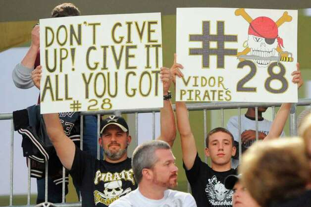 Vidor football fans honored Matt Thomas #28, the Pirates senior player who died after being hit by a train on Sunday. The Pirates took on the Central Jaguars at the BISD Thomas Center on Friday, October 21, 2011.  Valentino Mauricio/The Enterprise Photo: Valentino Mauricio