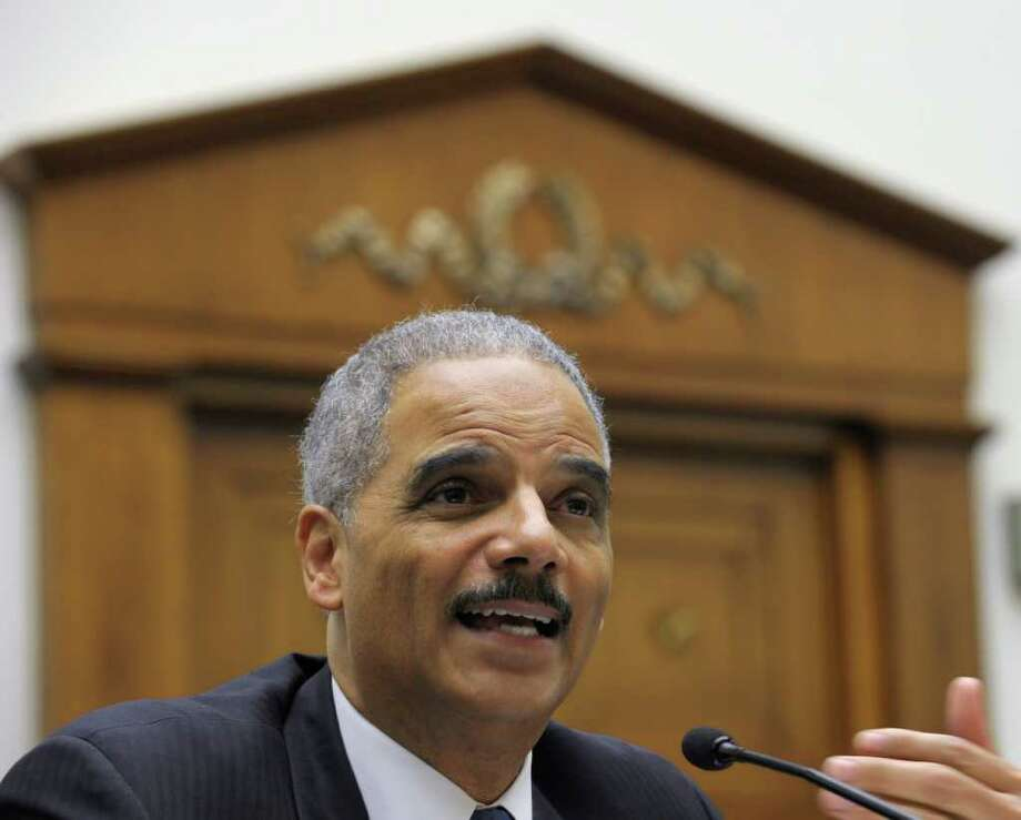 Eric Holder Photo: Associated Press, STF / AP
