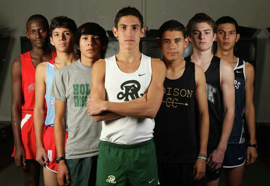 SPORTS -- The All-Area Volleyball Super Team Boys Cross Country Super Teams at Heroes Stadium, Wednesday, Dec. 7, 2011. From left, Alex Ntagawa (Lee High Schoo), Anthony Gallardo (Antonian), Ismael Partida (Holmes), Daniel Vertiz (Reagan), Omar Trevino (Edison), Austin Wells (Clark), Stephen Tankersley (Boerne Champion). JERRY LARA/glara@express-news.net Photo: JERRY LARA, San Antonio Express-News / SAN ANTONIO EXPRESS-NEWS