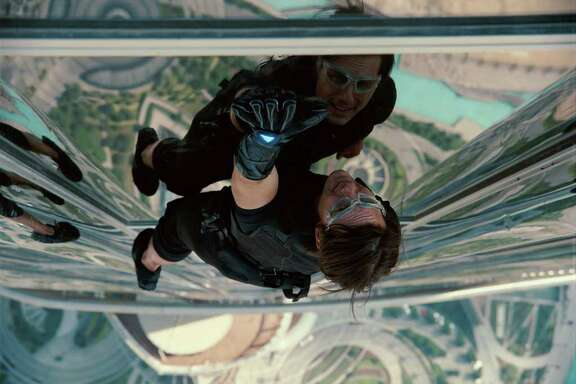 """In this image released by Paramount Pictures, Tom Cruise reprises his role as Ethan Hunt in a scene from """"Mission: Impossible - Ghost Protocol."""""""