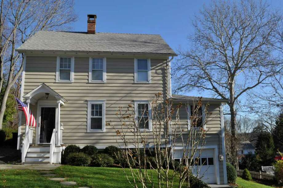 Modest westport colonial has two driveways two garages for Separate garage