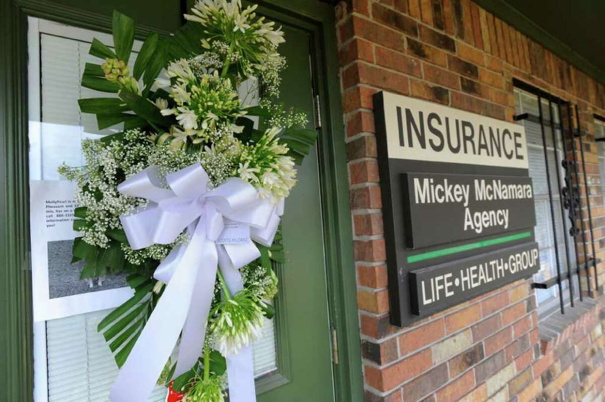 A wreath and flowers were placed as a memorial to longtime insurance agent Mickey McNamara, 76, who was beaten to death at his place of business in April, 2010 in Orange. Enterprise file photo