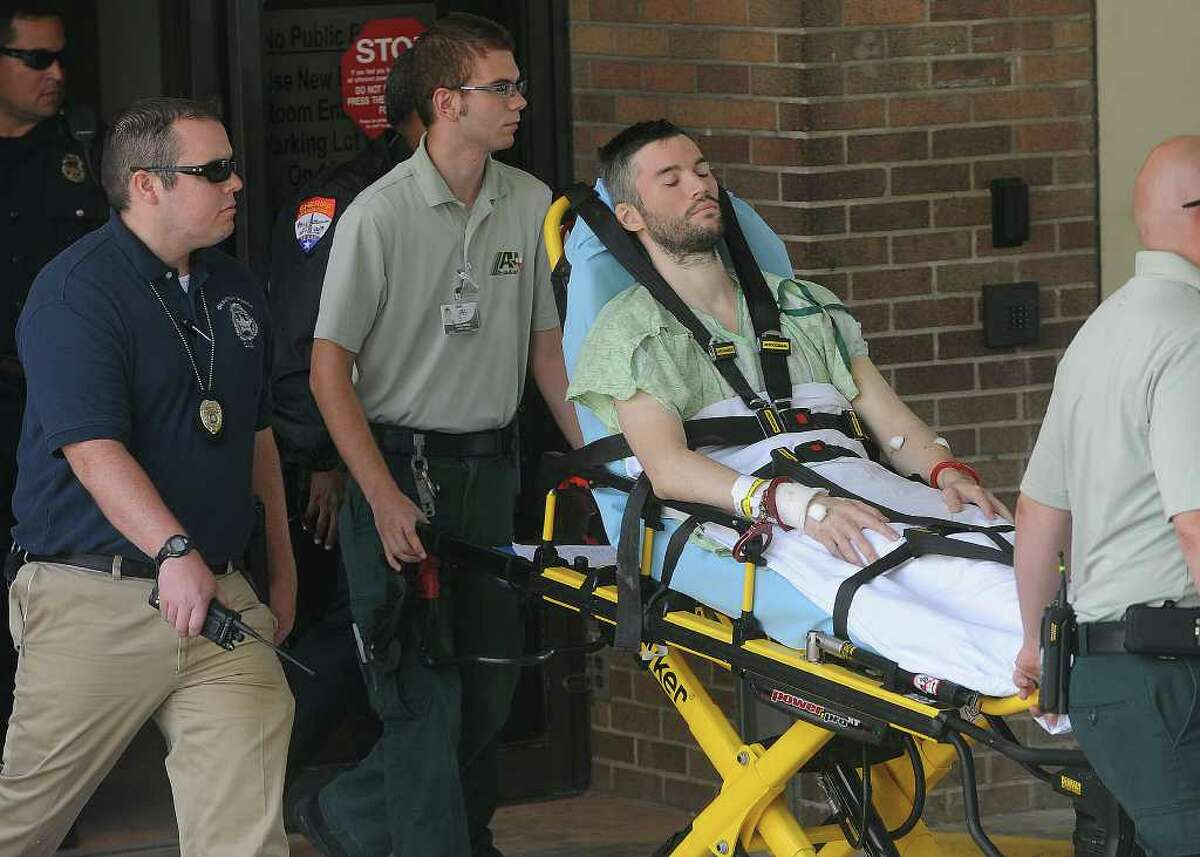 Handcuffed to the stretcher, John Wesley Nero was released from Christus St. Elizabeth Hospital Monday afternoon and was transported to jail. Nero is said to be the driver of the car that killed Beaumont Police Officer Bryan Hebert on July 8. Guiseppe Barranco/The Enterprise