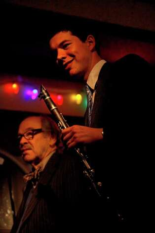Jim Cullum, left, of The Jim Cullum Jazz Band, takes a break as he plays with clarinetist Evan Arntzen at Tucker's Kozy Korner. Photo: LISA KRANTZ, STAFF / SAN ANTONIO EXPRESS-NEWS