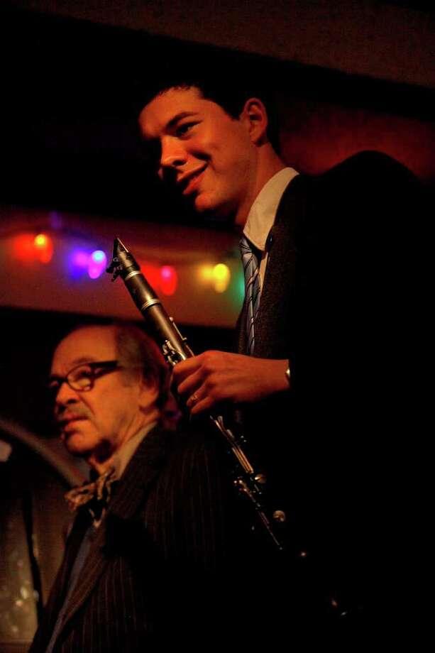 Jim Cullum, left, of The Jim Cullum Jazz Band, takes a break as he plays with clarinetist Evan Arntzen at Tucker's Kozy Korner. Photo: LISA KRANTZ, STAFF / SAN ANTONIO EXPRESS-NEWS