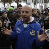 Anthony (Longshore member who declined to give last name) talks with protesters telling them that Longshore members were sent home for the day and wouldn't be paid in front of the entrance to Berths 55 and 56 at the Port of Oakland on Monday, December 12, 2011 in Oakland, Calif. Almost half the berths at the Port of Oakland have temporarily ceased operations Monday after hundreds of protesters spent the morning blocking intersections in the port.