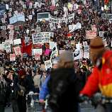Occupy Oakland protestors march to the port to shut it down in Oakland, Calif., Monday, December 12, 2011.