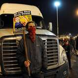 Protesters are seen at the Port of Oakland on Monday, Dec. 12, 2011, in Oakland, Calif.