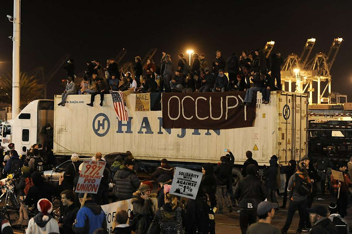 Protesters are seen on top of a truck at the Port of Oakland after shutting down operations on Monday, Dec. 12, 2011, in Oakland, Calif.